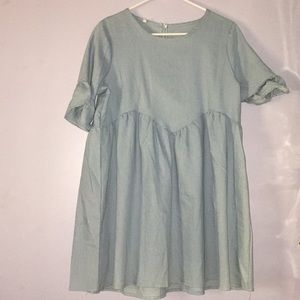 Baby blue long shirt or dress.
